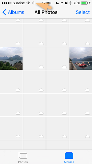 photos in camera roll with cloud icon