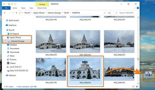 Drag and drop photos to PC using Windows Explorer